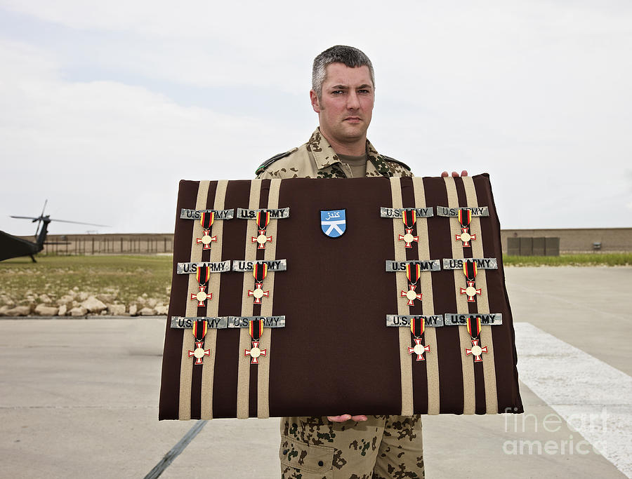 Afghanistan Photograph - A German Soldier Holds A Display by Terry Moore