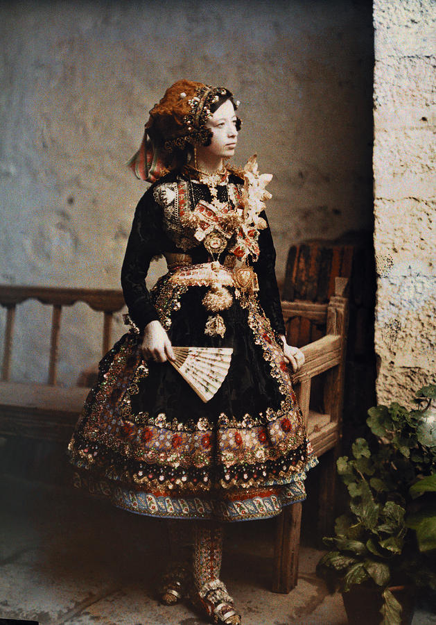 Outdoors Photograph - A Girl Poses In Her Traditional Costume by Gervais Courtellemont