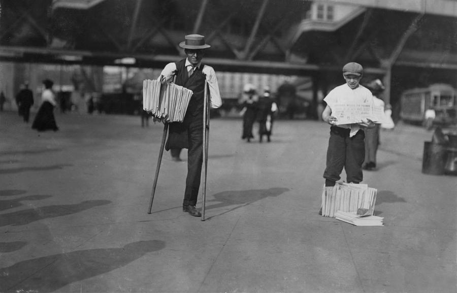 1910s Photograph - A Handicapped Man Selling Newspapers by Everett
