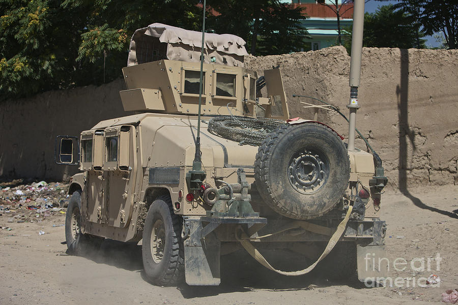 Hmmwv Photograph - A Humvee Patrols The Streets Of Kunduz by Terry Moore