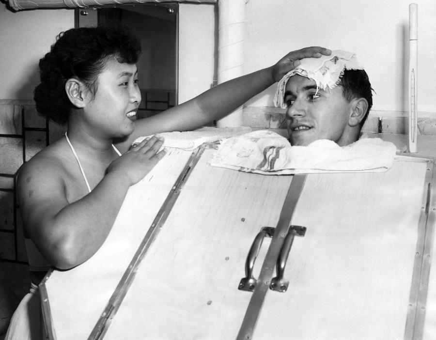 1950s Photograph - A Japanese Masseuse Applies A Cold by Everett