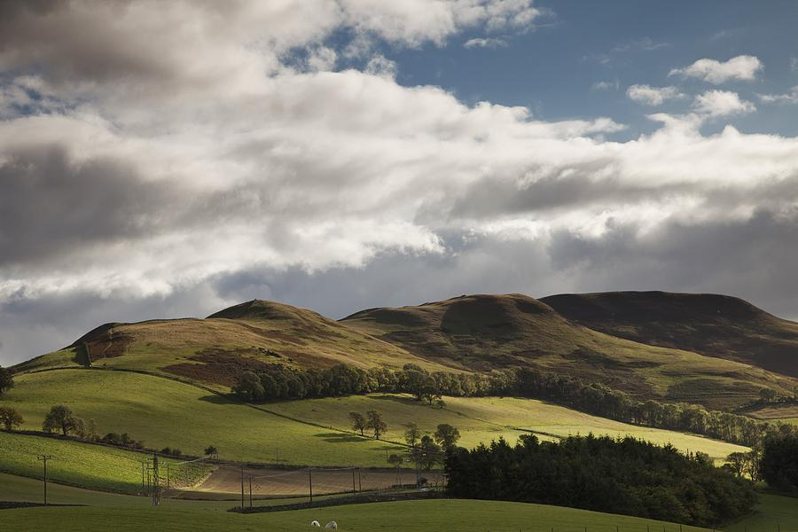Rolling Hills Photograph - A Landscape With Rolling Hills And by John Short