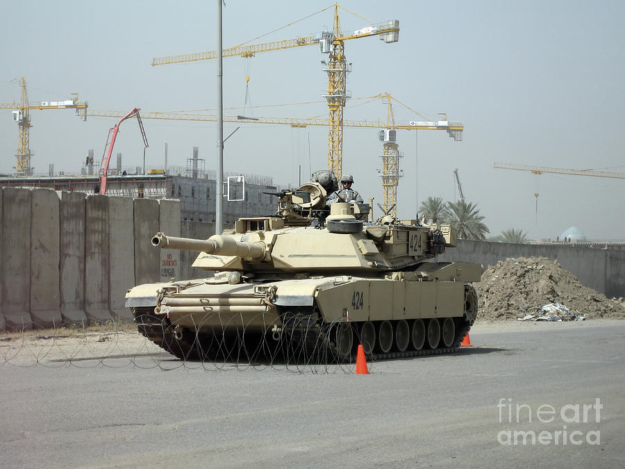 Baghdad Photograph - A M1 Abram Sits Out Front Of The New by Terry Moore