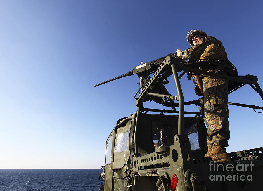 Camouflage Clothing Photograph - A Machine Gunner Mounts A M-2 by Stocktrek Images