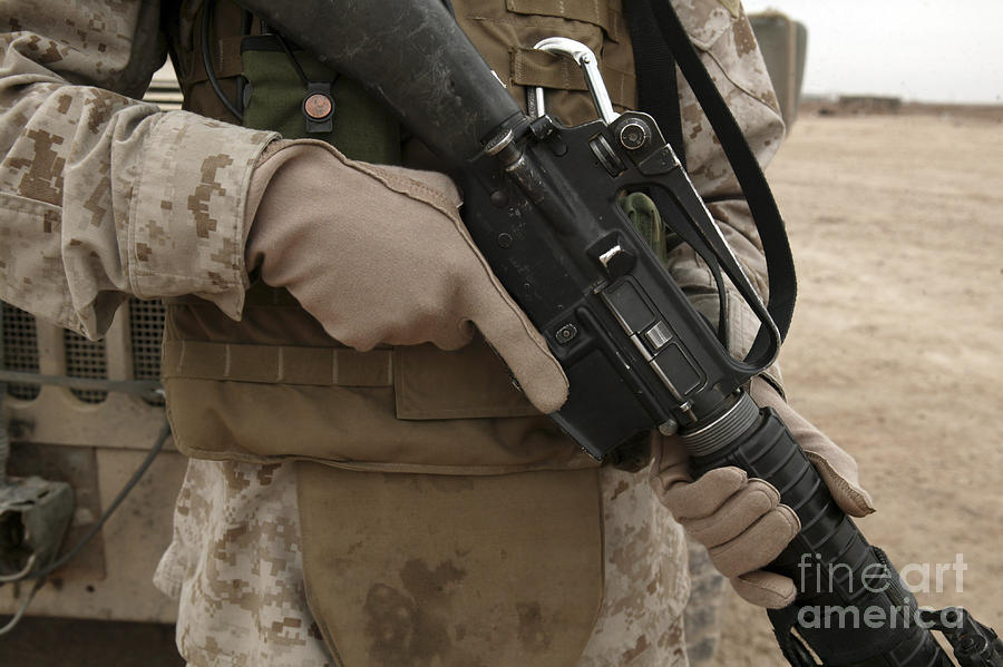 A Marine Displays The Required Hand Photograph