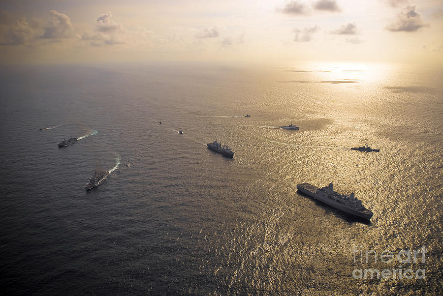 Reflecting Photograph - A Multi-national Naval Force Navigates by Stocktrek Images