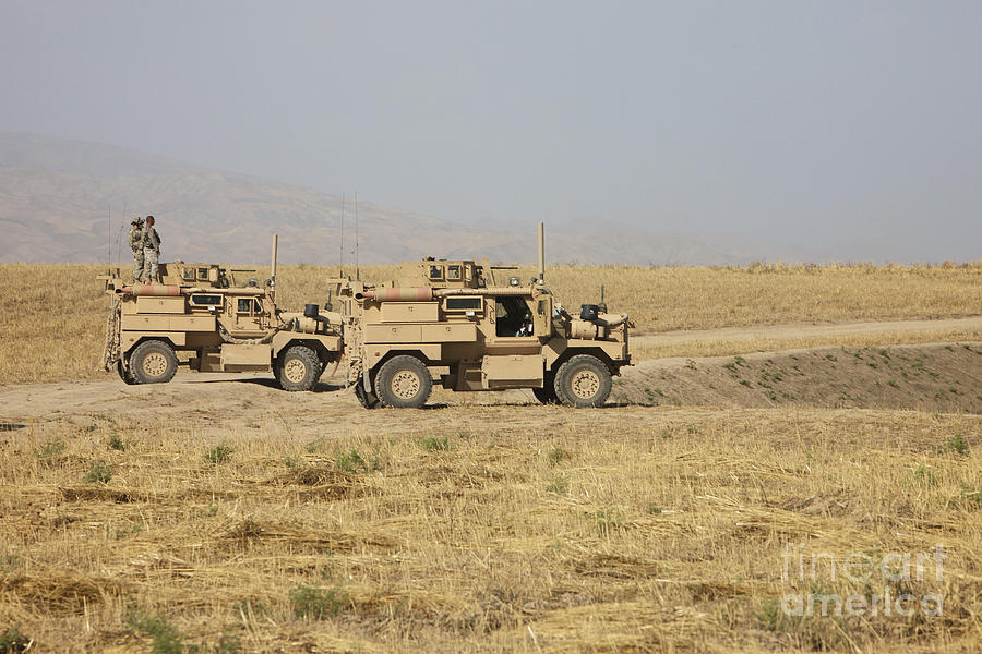Arid Climate Photograph - A Pair Of U.s. Army Cougar Mrap by Terry Moore