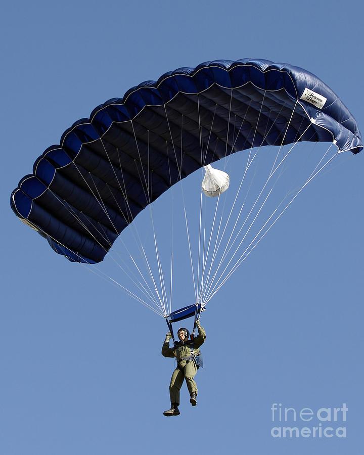 Sky Photograph - A Paratrooper Descends Through The Sky by Stocktrek Images