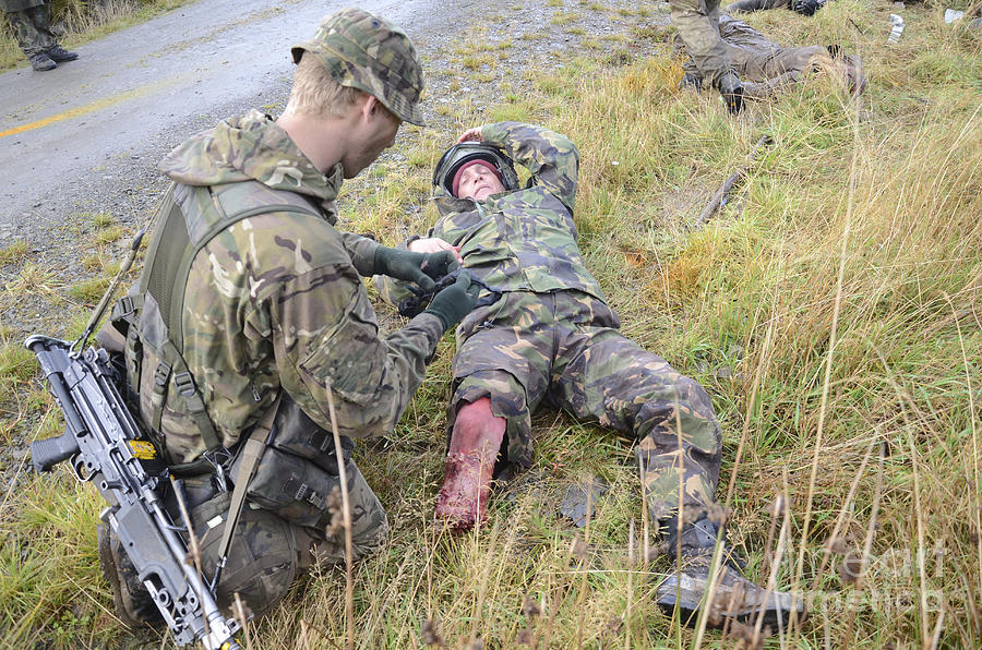 United Kingdom Photograph - A Patrol Medic Applies First Aid by Andrew Chittock