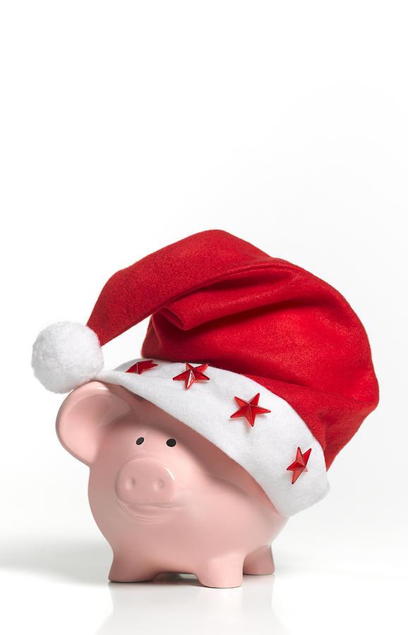 A Piggy Bank Wearing A Santa Hat Photograph by Peter Dazeley