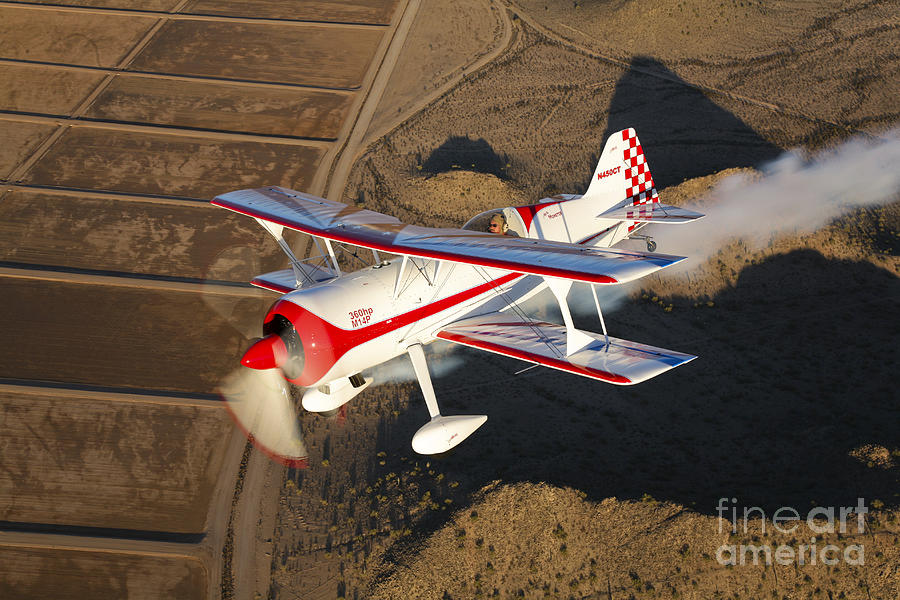 Transportation Photograph - A Pitts Model 12 Aircraft In Flight by Scott Germain