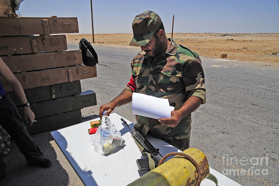 Benghazi Photograph - A Rebel Collects His Food Ration by Andrew Chittock