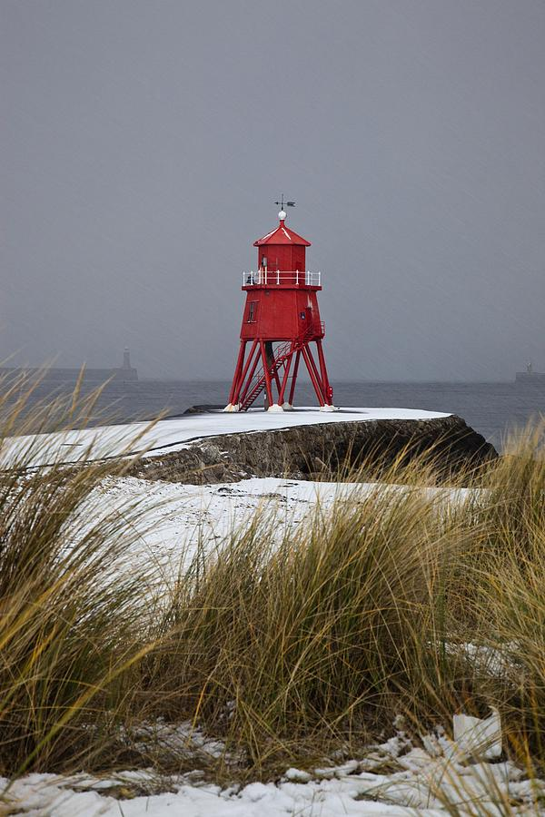 Snow Photograph - A Red Lighthouse Along The Coast South by John Short