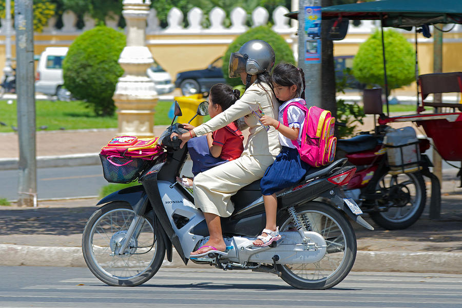Asia Photograph - A Ride To School. by David Freuthal