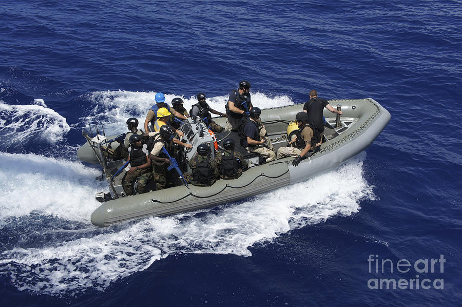 Inflatable Boats Photograph - A Rigid-hull Inflatable Boat Carrying by Stocktrek Images