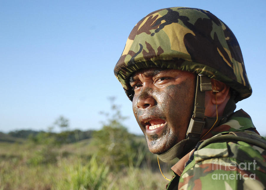 Yelling Photograph - A Royal Brunei Land Force Soldier by Stocktrek Images