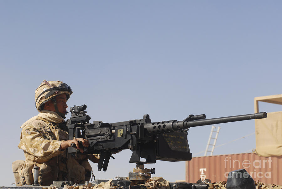 Middle East Photograph - A Royal Marine Manning A .50 Caliber by Andrew Chittock