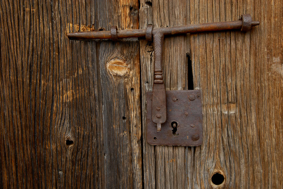 A Rusty Barn Door Lock On An Old Photograph By Medford Taylor