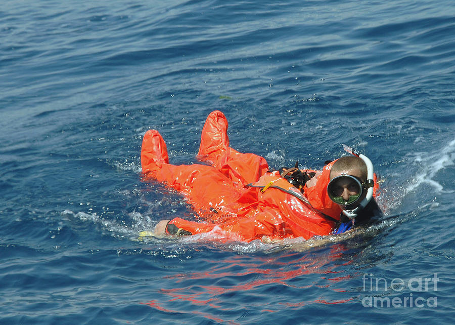 Color Image Photograph - A Sailor Rescued By A Diver by Stocktrek Images