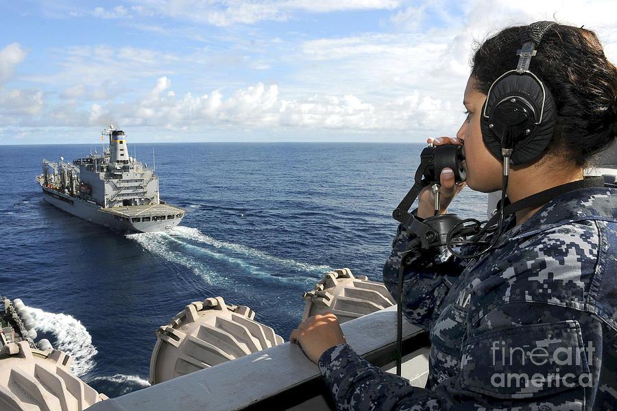 Maritime Photograph - A Sailor Stands Forward Lookout Watch by Stocktrek Images