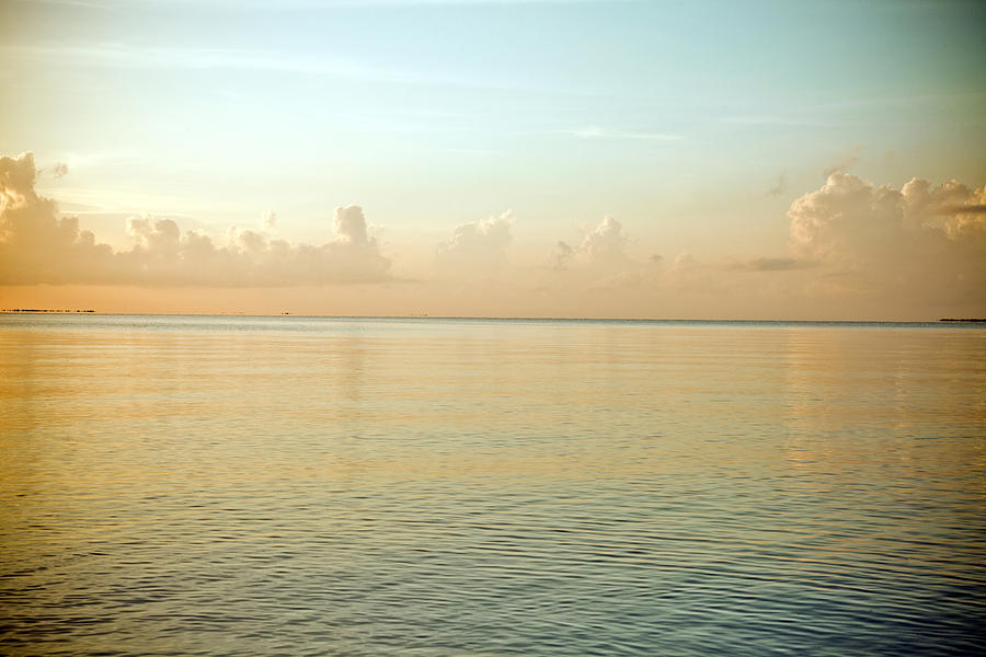 Horizontal Photograph - A Serene Landscape Of The Ocean And Sky At Sunrise by Adam Hester