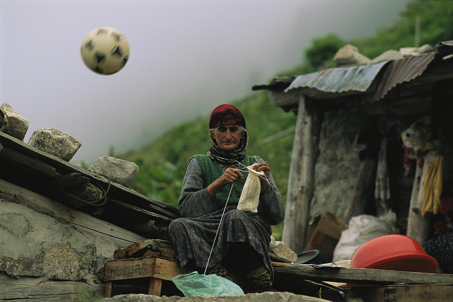 Peoples Photograph - A Soccer Ball Flies Over The Head by Randy Olson