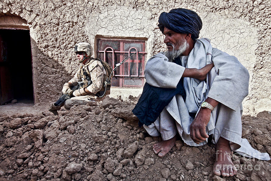 Middle East Photograph - A Soldier Collects Information by Stocktrek Images