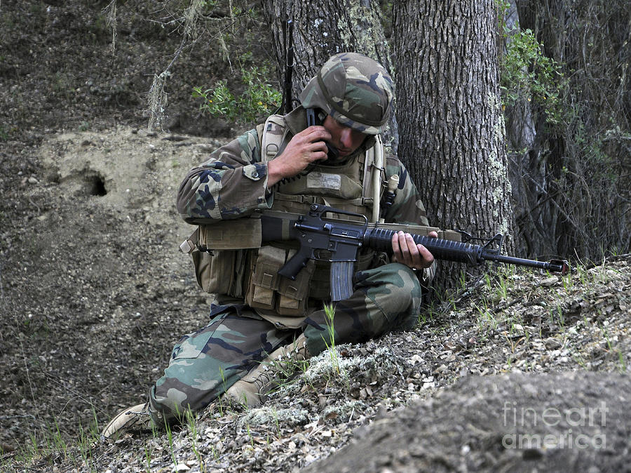 Battleground Photograph - A Soldier Communicates His Position by Stocktrek Images