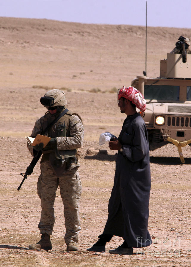 Color Image Photograph - A Soldier Communicates With A Local by Stocktrek Images