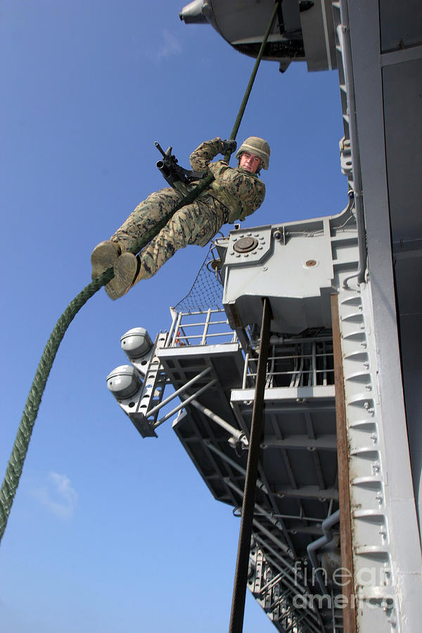 Aircraft Photograph - A Soldier Fast-ropes From The Rear by Stocktrek Images