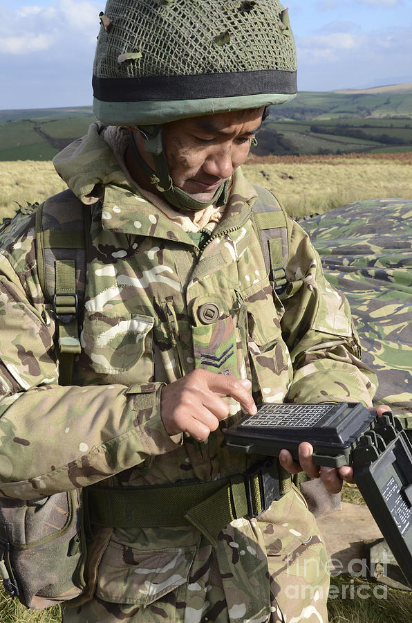 Soldier Photograph - A Soldier Inputs The Firing Data by Andrew Chittock