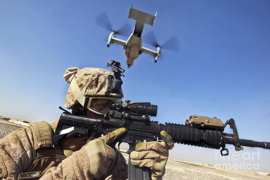 A Soldier Provides Security As An Mv-22 Photograph