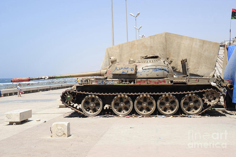 Benghazi Photograph - A T-55 Tank On The Seafront by Andrew Chittock
