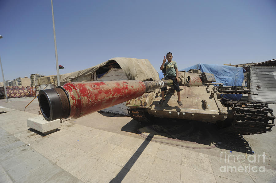 Benghazi Photograph - A T-55 Tank With Two Children Playing by Andrew Chittock