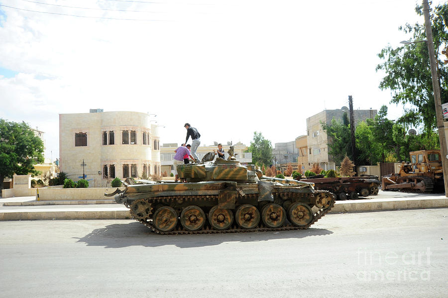 Free Syrian Army Photograph - A T-72 Main Battle Tank On The Streets by Andrew Chittock
