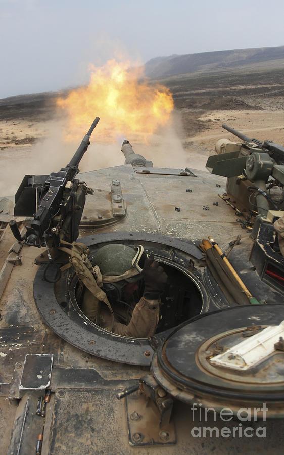 M1a1 Abrams Photograph - A Tank Crewman Braces Himself by Stocktrek Images