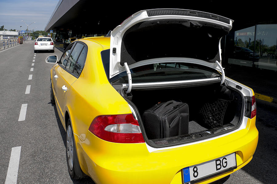 None Photograph - A Taxi At Tallinn Airport. Open Trunk by Jaak Nilson