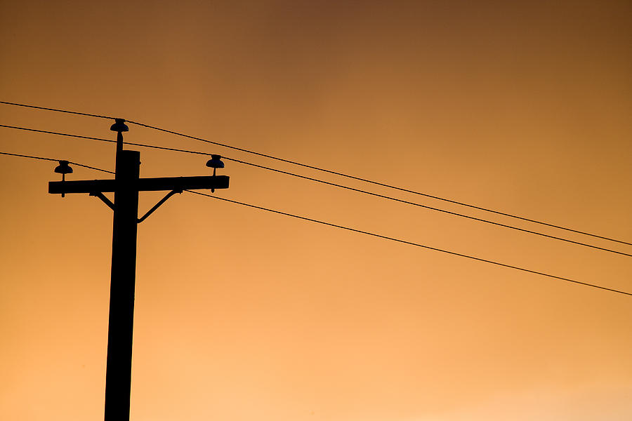 A Telephone Pole At Sunset Photograph by Pete Ryan