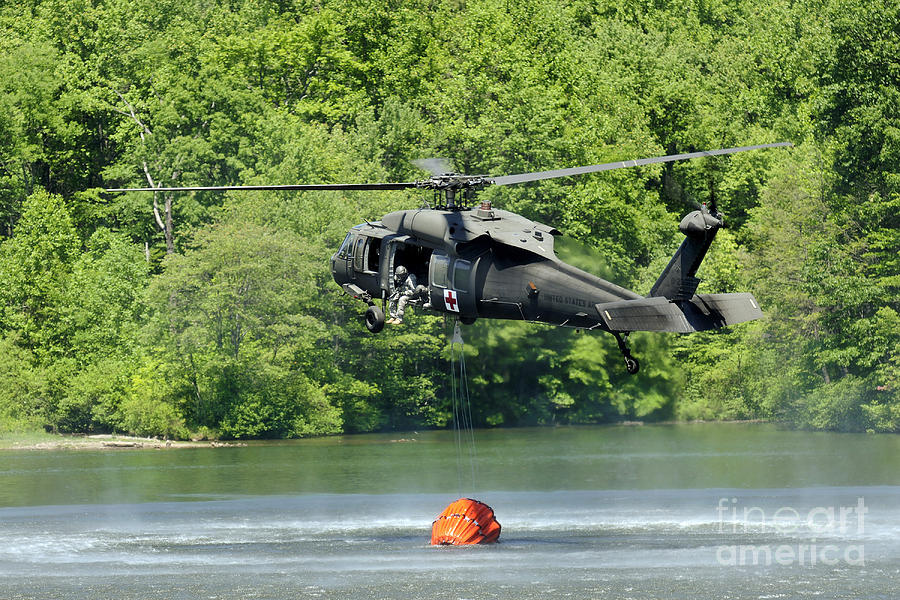 Fort Indiantown Gap Photograph - A Uh-60 Blackhawk Helicopter Fills by Stocktrek Images