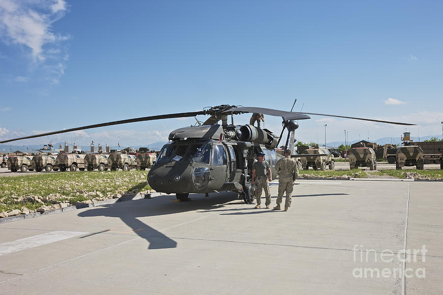 Operation Enduring Freedom Photograph - A Uh-60l Blackhawk Parked On Its Pad by Terry Moore