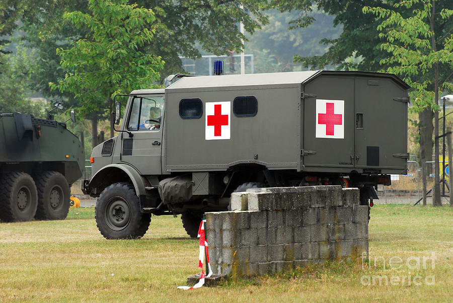 Military Photograph - A Unimog In An Ambulance Version In Use by Luc De Jaeger