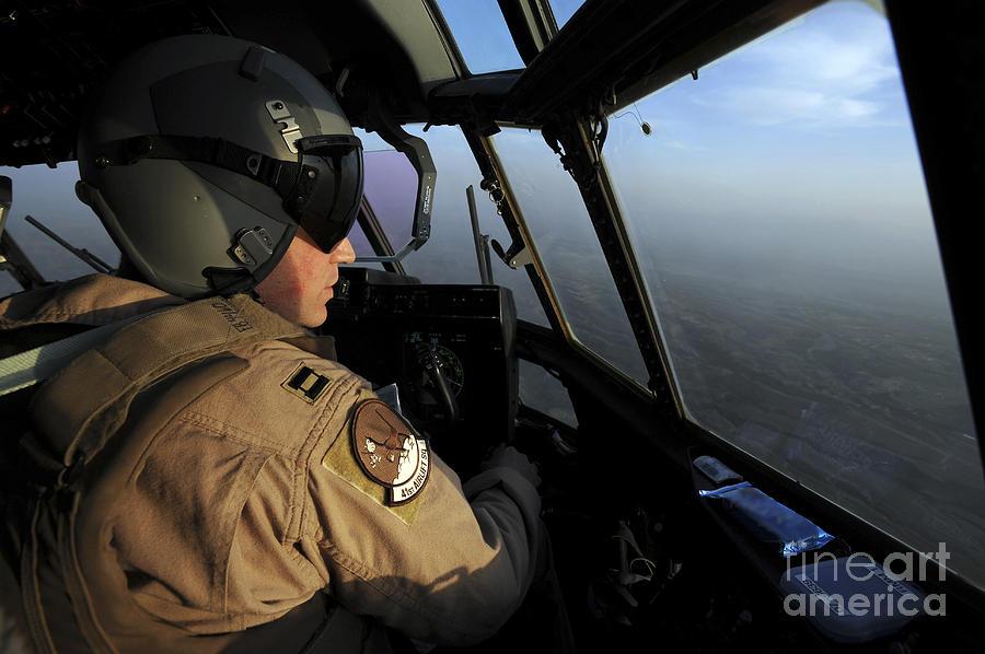 Cockpit Photograph - A U.s. Air Force C-130j Hercules Pilot by Stocktrek Images