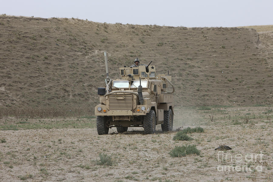 Mrap Photograph - A U.s. Army Cougar Patrols A Wadi by Terry Moore