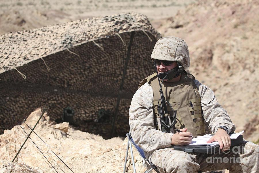 Men Photograph - A U.s. Marine Communicates With Close by Stocktrek Images