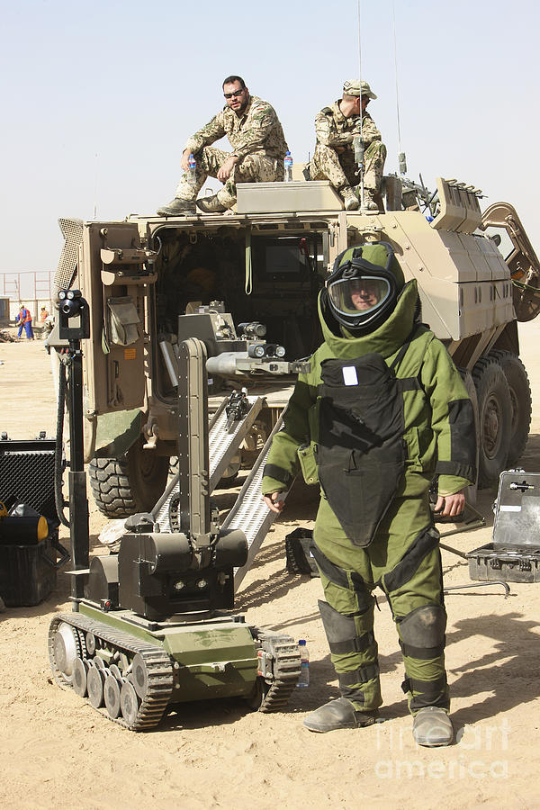 Kunduz Photograph - A U.s. Marine Dressed In A Bomb Suit by Terry Moore