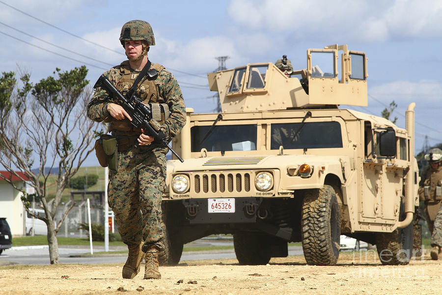 A U.s. Marine Guides A Humvee Photograph by Stocktrek Images