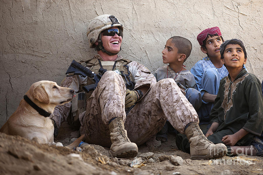 Marine Photograph - A U.s. Marine Jokes With Afghan by Stocktrek Images