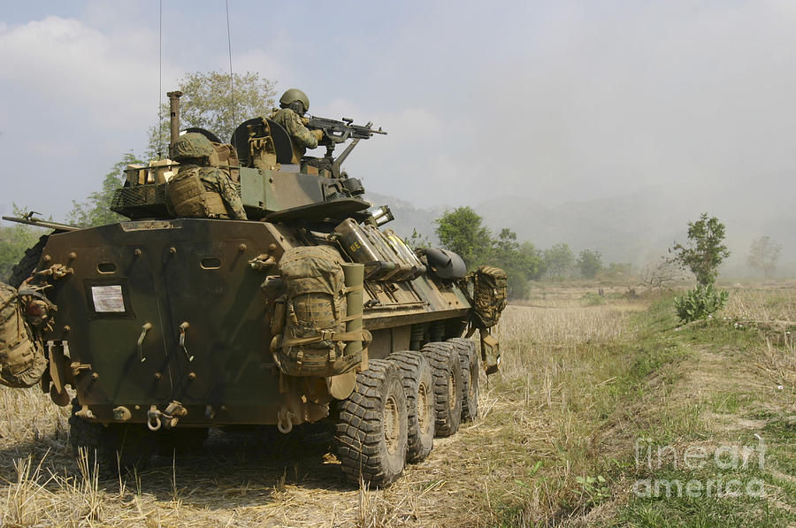 Marine Expeditionary Unit Photograph - A U.s. Marine Uses An M-240b Machine by Stocktrek Images