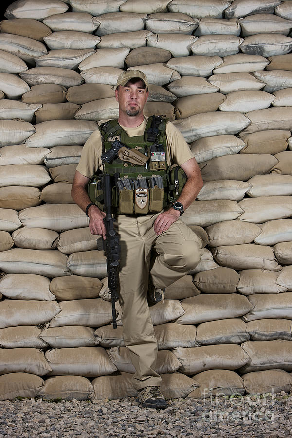 Operation Enduring Freedom Photograph - A U.s. Police Officer Contractor Leans by Terry Moore