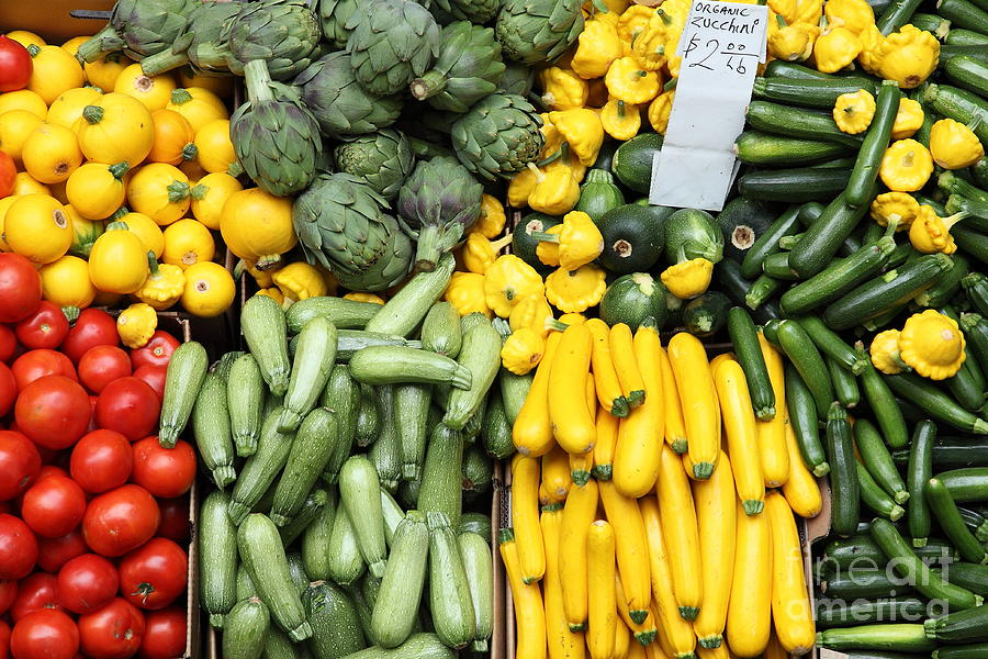 A variety of fresh tomatoes zucchinis and artichokes for Fresh art photography facebook